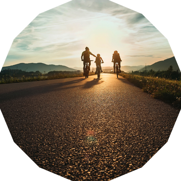 Three people cycling in the countryside